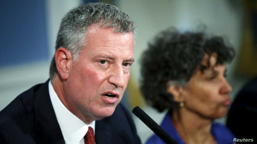 FILE- New York City Mayor Bill de Blasio speaks to the media during a news conference.