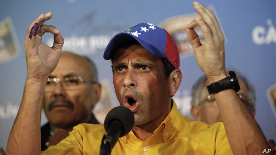 Opposition presidential candidate Henrique Capriles talked to journalists after official results of the presidential elections were announced in Caracas, Venezuela, early April 15, 2013.