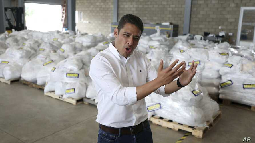 Venezuelan exiled lawmaker Jose Manuel Olivares talks to the media during a tour to see stored humanitarian aid at a warehouse next to the Tienditas International Bridge on the outskirts of Cucuta, Colombia, on the border with Venezuela, Feb. 19, 201