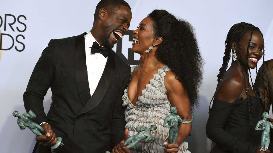 """Sterling K. Brown, left, laughs with Angela Bassett, winner of the award for  """"Black Panther"""" at the 25th annual Screen Actors Guild Awards at the Shrine Auditorium & Expo Hall on Sunday, Jan. 27, 2019, in Los Angeles."""