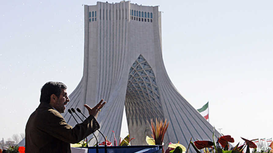 Iranian President Mahmoud Ahmadinejad gestures as he deliver his speech near the Azadi (freedom) tower at a rally to mark the 33rd anniversary of the Islamic Revolution that toppled the country's pro-Western monarchy and brought Islamic clerics to po