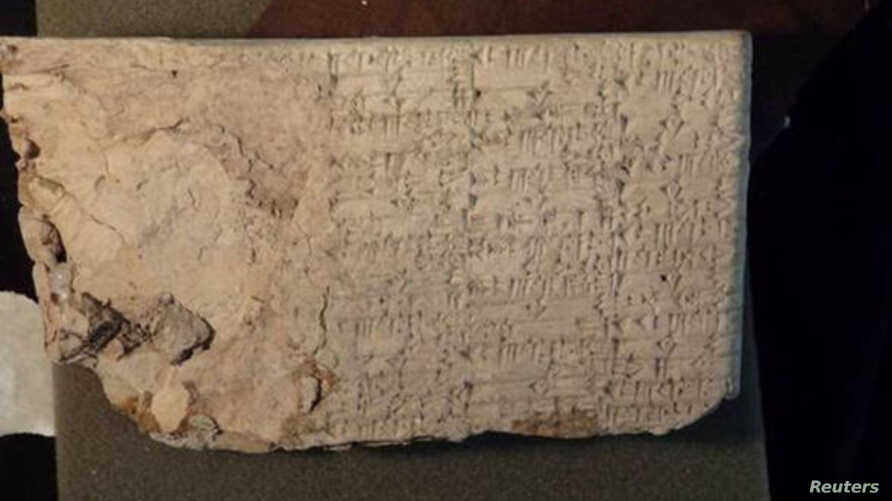 FILE - A cuneiform tablet, an ancient clay artifact that originated in modern-day Iraq is seen in this undated handout photo obtained by Reuters.