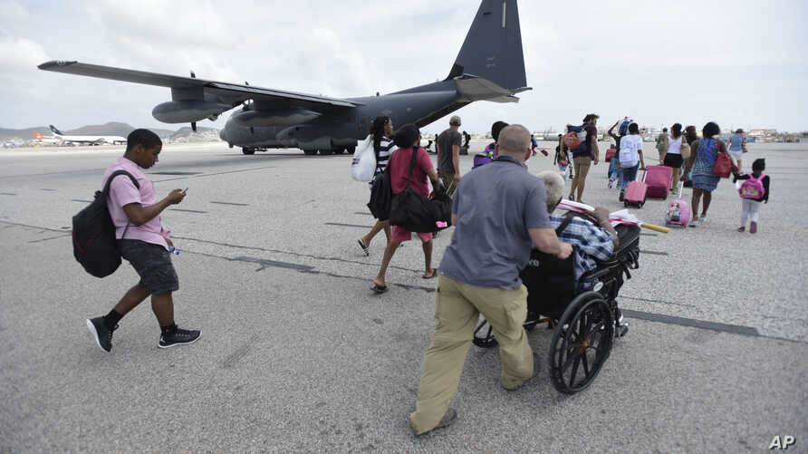 U.S. Air force personnel evacuate residents from Princes Juliana International Airport after the passage of Hurricane Irma, in St. Martin, Sept. 12, 2017. Irma cut a path of devastation across the northern Caribbean, leaving thousands homeless after