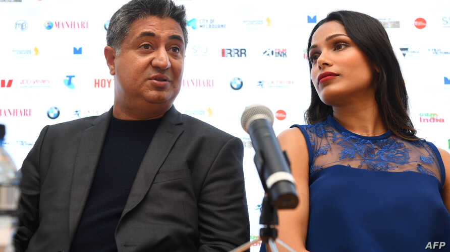 Indian film director Tabrez Noorani, left, answers a question with Bollywood and Hollywood actress Freida Pinto during a press conference on the opening day of the Indian Film Festival of Melbourne on August 10, 2018. Noorani's film 'Love Sonia' whic