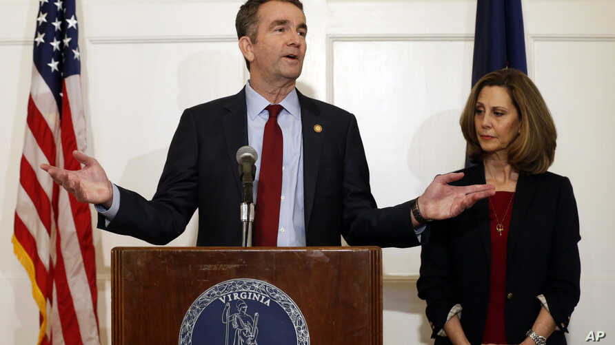 Virginia Gov. Ralph Northam, left, gestures as his wife, Pam, listens during a press conference in the Governor's Mansion at the Capitol in Richmond, Virginia, Feb. 2, 2019.