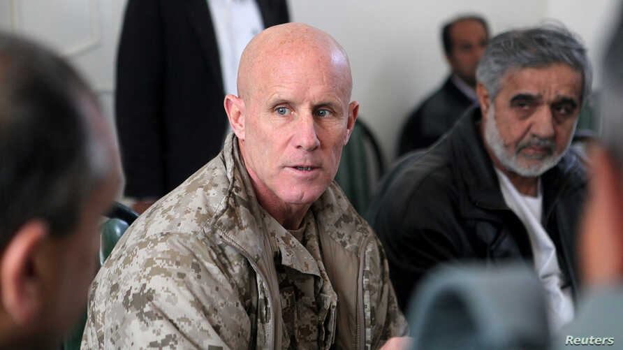 FILE - Vice Adm. Robert Harward, commanding officer of Combined Joint Interagency Task Force 435, speaks to an Afghan official during his visit to Zaranj, Afghanistan, Jan. 6, 2011.
