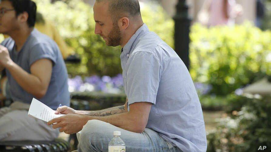 Iraq War veteran Kristofer Goldsmith sits in a campus park after his last final exam of the semester at Columbia University in New York, May 9, 2018.