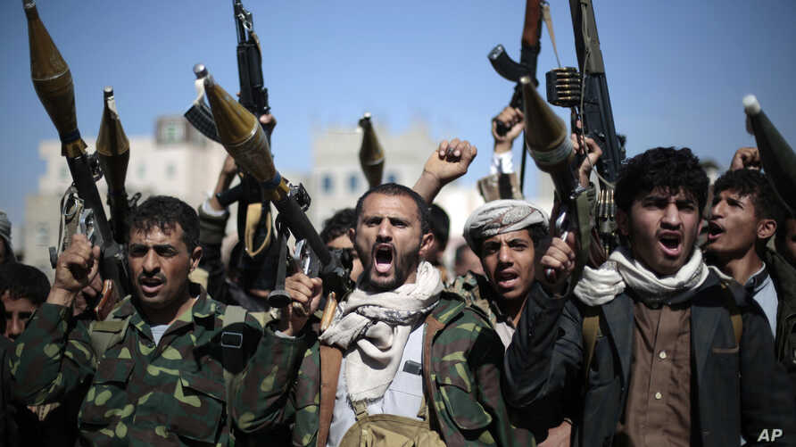 Tribesmen loyal to Houthi rebels hold their weapons as they chant slogans during a gathering aimed at mobilizing more fighters into battlefronts in several Yemeni cities, in Sanaa, Yemen, Nov. 24, 2016.