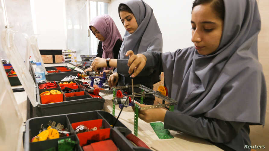 Members of Afghan robotics girls team which was denied entry into the United States for a competition, work on their robots in Herat province, Afghanistan July 4, 2017.