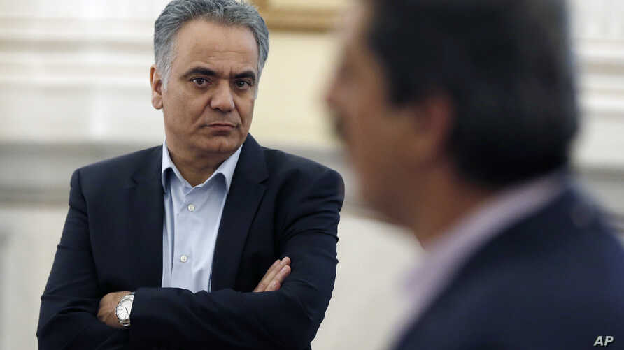 FILE - New Energy Minister Panos Skourletis attends a swearing in ceremony at the Presidential Palace in Athens, July 18, 2015.