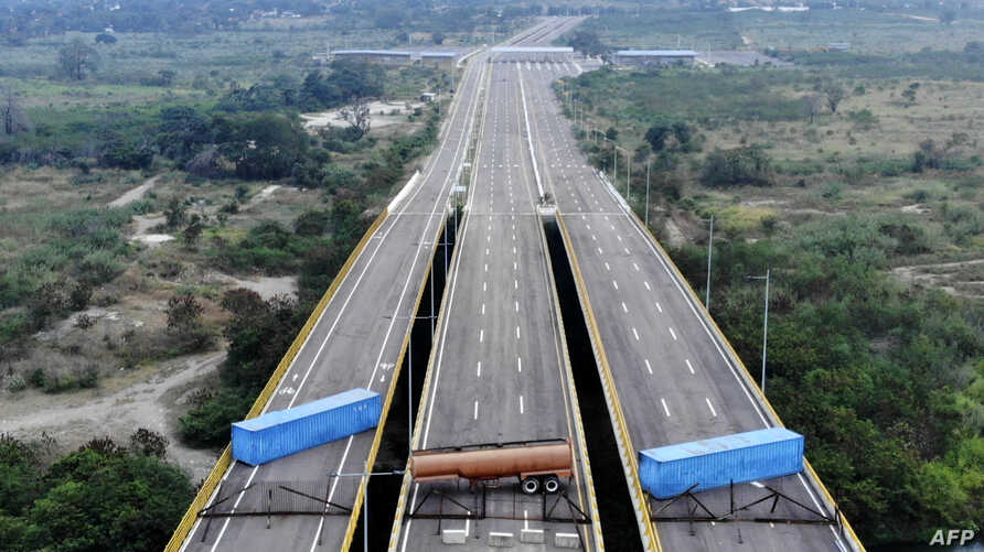 Aerial view of the Tienditas Bridge, in the border between Cucuta, Colombia and Tachira, Venezuela, after Venezuelan military forces blocked it with containers on February 6, 2019.