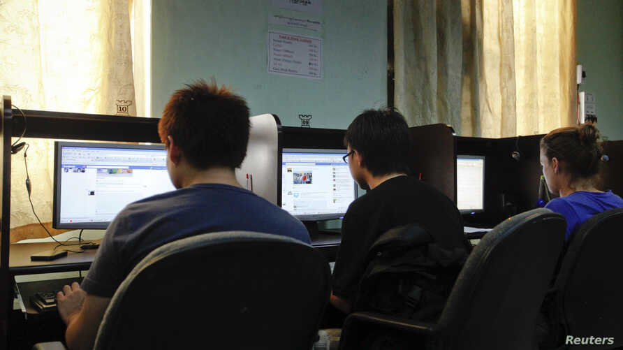 People use the use computers at an internet cafe in Rangoon, Nov. 21, 2011.