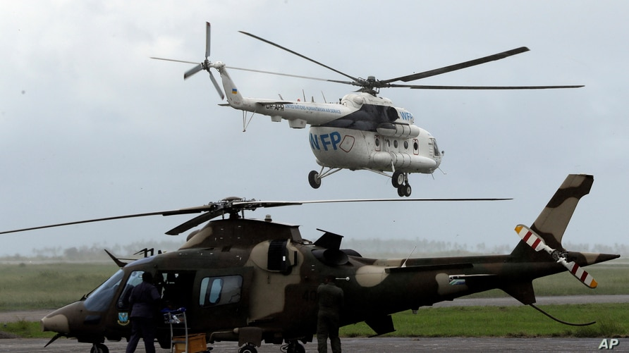 A World Food Programme (WFP) helicopter takes off, in Beira, Mozambique, March 22, 2019.