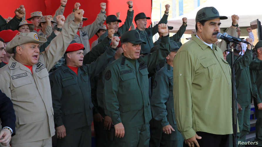 Venezuela's President Nicolas Maduro attends a military parade with the National Bolivarian Militia in Caracas, Venezuela, Dec. 17, 2018.