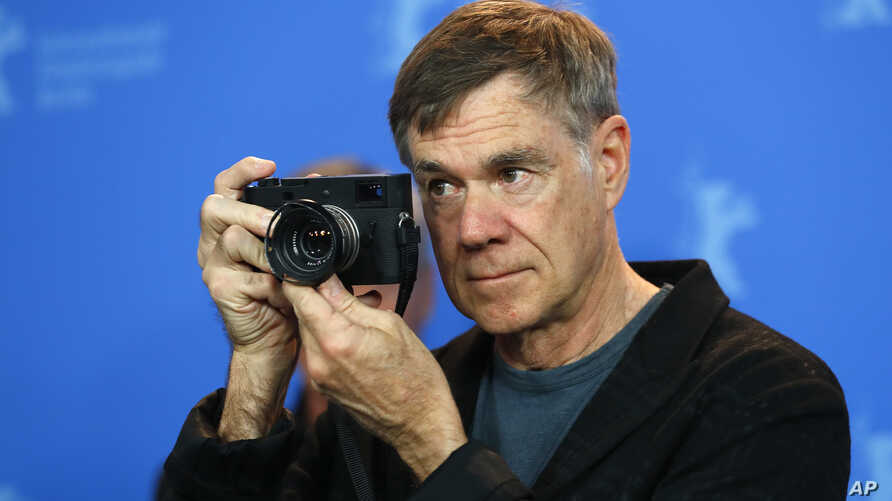 """Director, screenwriter and editor Gus Van Sant poses during a photocall to promote the movie """"Don't Worry, He Won't Get Far on Foot"""" at the 68th Berlinale International Film Festival in Berlin, Germany, Feb. 20, 2018."""