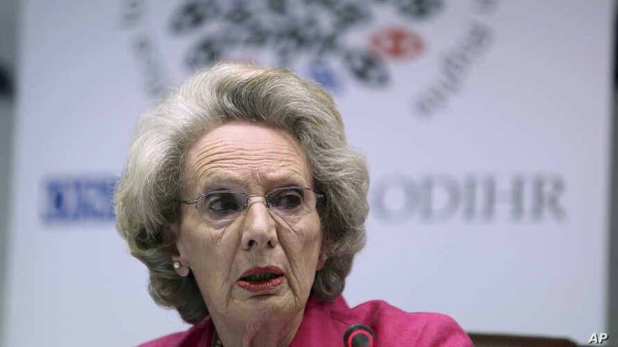 "FILE - Audrey Glover of the OSCE's Office for Democratic Institutions and Human Rights speaks at a news conference in Tirana, Albania, June 22, 2015. Glover said some decisions on U.S. voting rules ""appear to have had a partisan flavor"" and ""led to a"