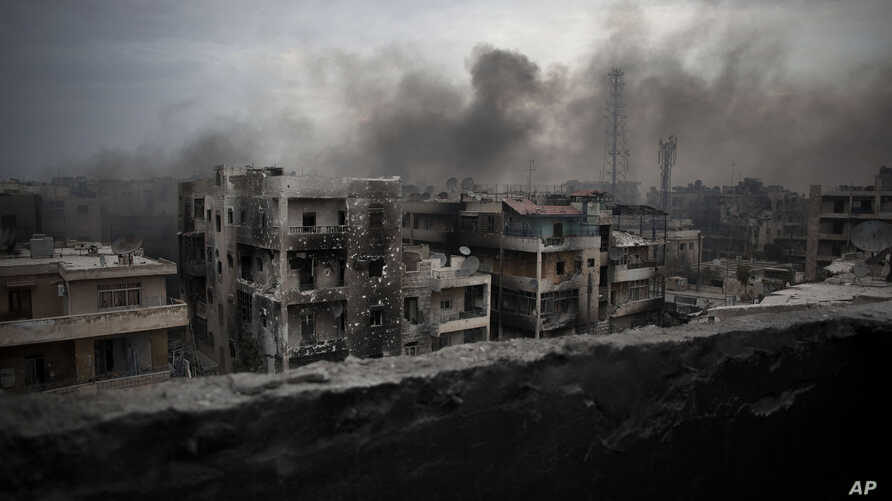 FILE - In this Tuesday, Oct. 2, 2012 file photo, smoke rises over Saif Al Dawla district, in Aleppo, Syria. Residents in the rebel-held districts of Aleppo have a reprieve from the incessant bombings by Syrian government warplanes and the promise of