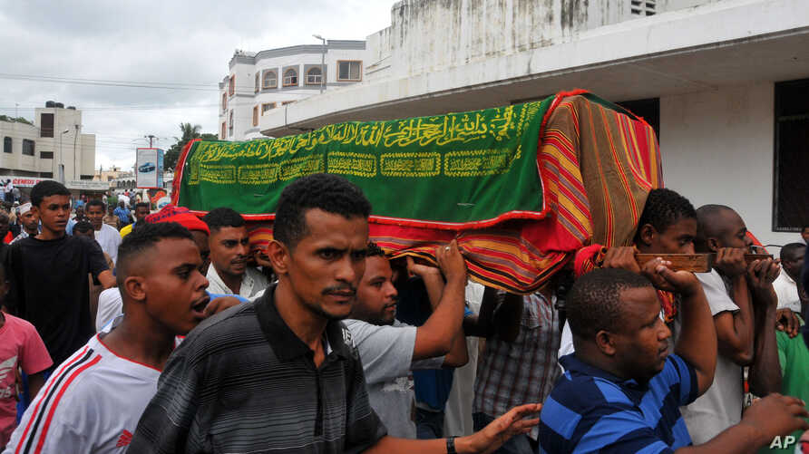Muslims carry a casket in Mombasa, Kenya, May 4, 2014, after an explosion killed four people at a bus stop on Saturday night.
