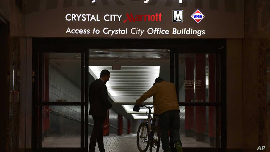 People walk in Crystal City, Va. Washington, D.C.'s subway system serves the Crystal City, Virginia, neighborhood that Amazon chose for one of its headquarters locations.