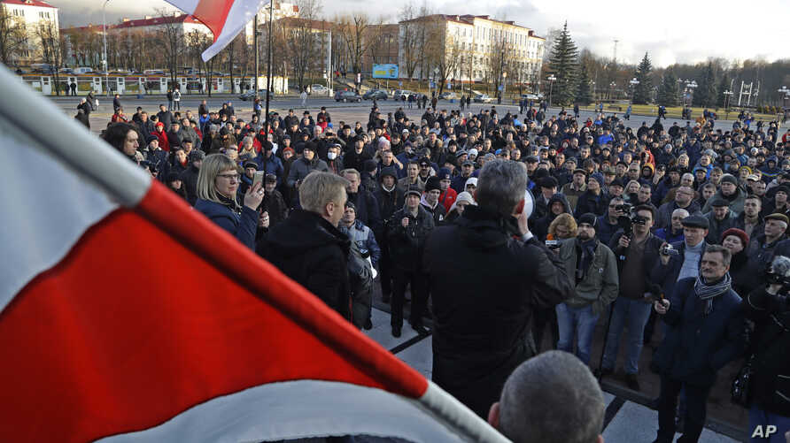 People shout slogans at a rally in the city of Maladzyechna, Belarus, March 10, 2017.