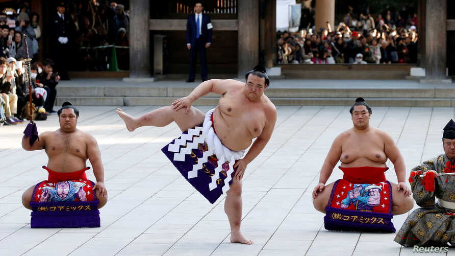 Japanese grand sumo champion Yokozuna Kisenosato performs the New Year's ring-entering rite at the annual celebration for the New Year at Meiji Shrine in Tokyo, Japan January 9, 2018.