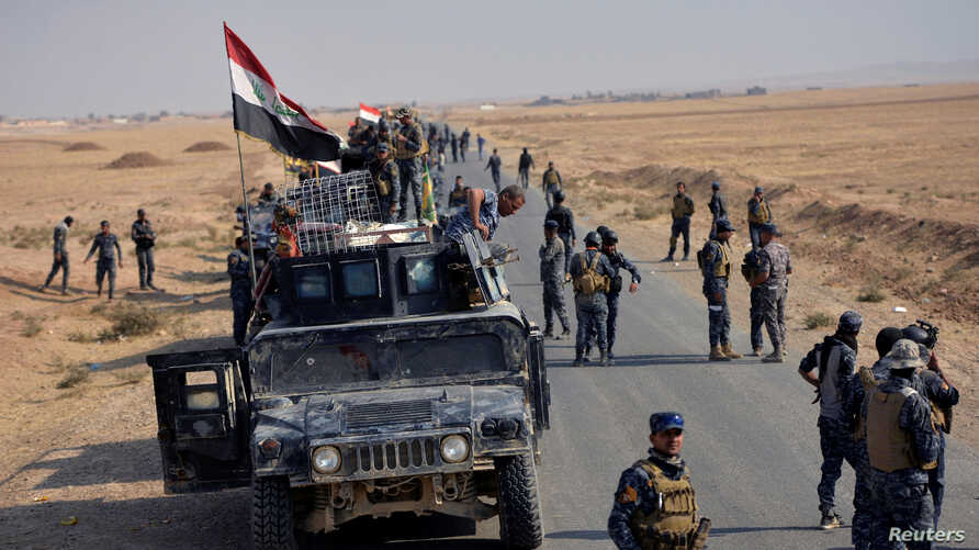 Federal police forces take part in an operation against Islamic State militants in south of Mosul, Oct. 26, 2016.