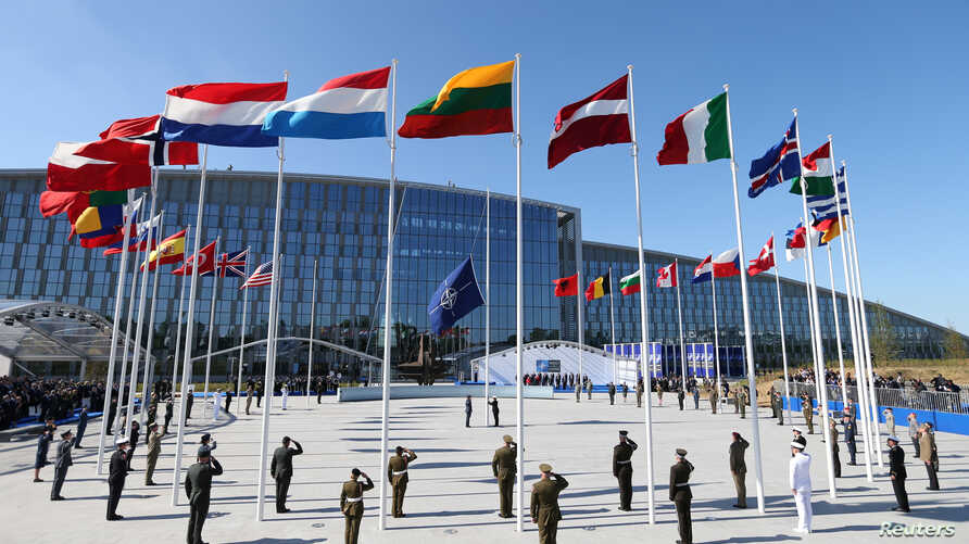 FILE - Flags of NATO member countries fly at the new NATO headquarters in Brussels, Belgium.