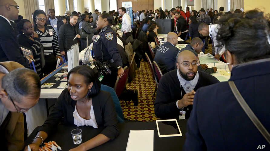 Job seekers attend the New York Department of Citywide Administrative Services (DCAS) 2016 job fair, Nov. 2, 2016, in New York.
