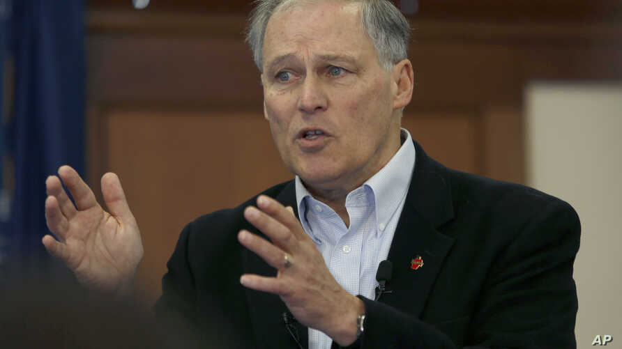 Washington Gov. Jay Inslee speaks to students at Saint Anselm College, Jan. 22, 2019, in Manchester, N.H.
