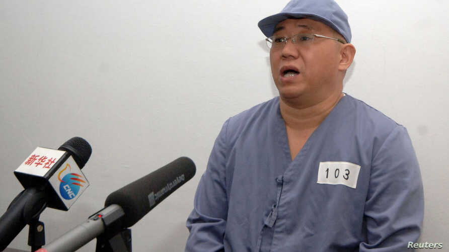 """FILE - Kenneth Bae, a Korean-American missionary who is serving a sentence in North Korea for """"hostile acts"""" appears before reporters in Pyongyang in this undated photo released by North Korea's Central News Agency (KCNA) on January 20, 2014."""