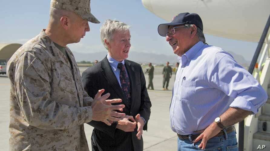 U.S. Defense Secretary Leon Panetta, right, speaks with U.S. Ambassador to Afghanistan Ryan Crocker, center, and the head of NATO coalition forces in Afghanistan Gen. John Allen upon his arrival at Kabul International Airport in Kabul, Afghanistan Ju