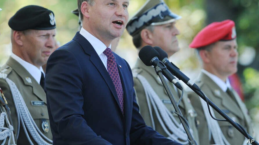 Polish President Andrzej Duda speaks during Polish Army Day celebrations in Warsaw, Poland, Saturday, Aug. 15, 2015.