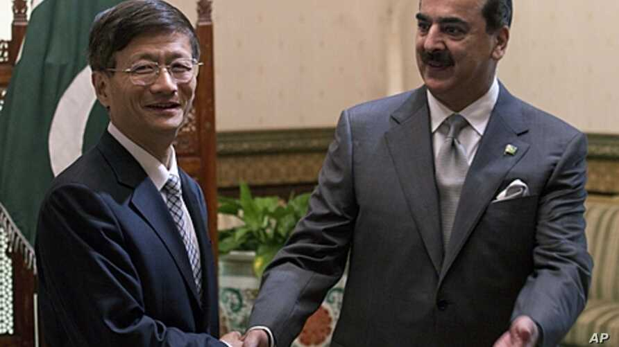 CChinese Public Security Minister Meng Jianzhu, left, shakes hands with Pakistan's Prime Minister Yusuf Raza Gilani in Islamabad, Pakistan. China's top security official is visiting Pakistan for talks focusing on increased cooperation against Chinese