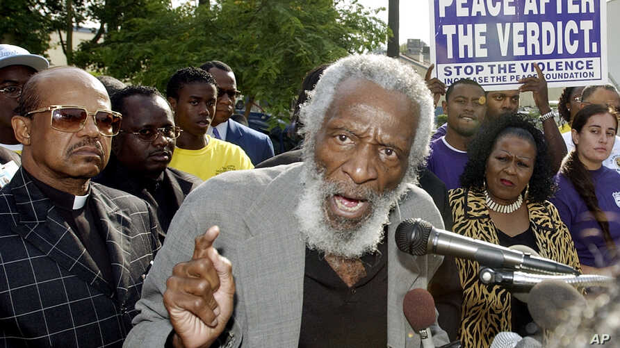 FILE - Comedian and activist Dick Gregory speaks at a peace vigil in Inglewood, Calif., July 29, 2003.