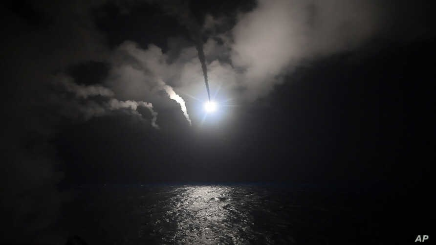 The U.S. Navy guided-missile destroyer USS Porter launches a Tomahawk missile in the Mediterranean Sea, April 7, 2017. The United States blasted a Syrian airfield with a barrage of cruise missiles in retaliation for this week's chemical weapons atta...