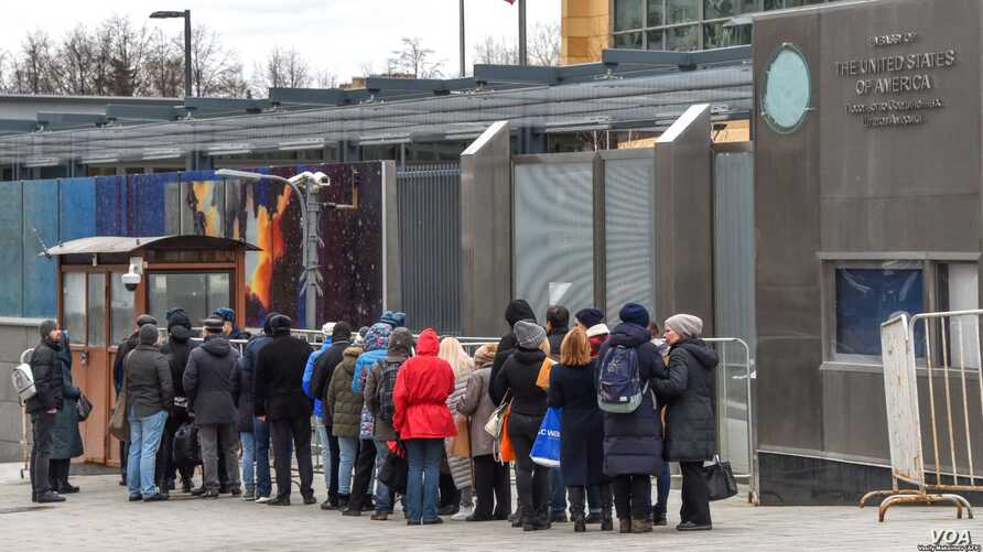 People queue for visas and other consular services at the U.S. embassy in Moscow. Asylum applications surged by nearly 40 percent last year, the fifth year in a row in which there has been an increase in the number of Russians seeking refuge in the U