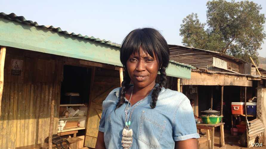 Mariatu Sesay stands in front of her cafe which she runs and also teaches catering skills to sex workers there. Goderich, Sierra Leone, Jan. 17, 2018 (N.deVries/VOA)