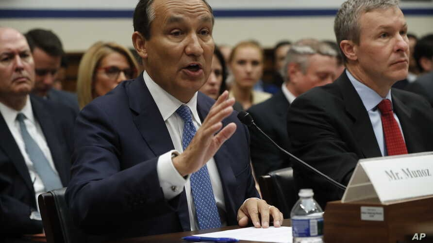 United Airlines CEO Oscar Munoz, left, accompanied by United Airlines President Scott Kirby, appears on Capitol Hill in Washington, May 2, 2017, to testify before a House Transportation Committee oversight hearing.
