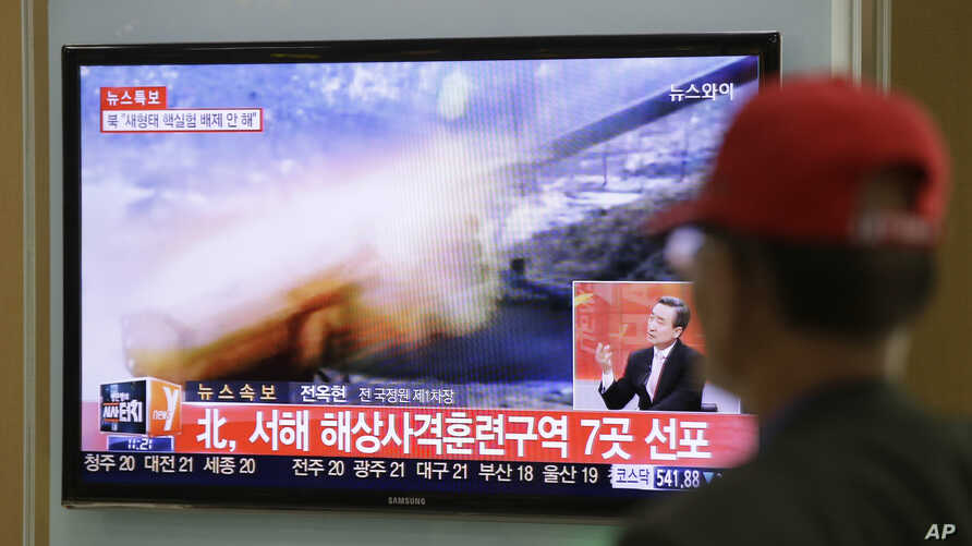 A man watches a television news program reporting about North Korea's plan to conduct live-fire drills, at a Seoul train station in Seoul, South Korea, Monday, March 31, 2014.