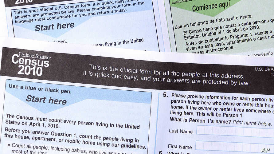 FILE - Copies of the 2010 Census forms are seen during a news conference in Phoenix, Arisona, March 15, 2010.