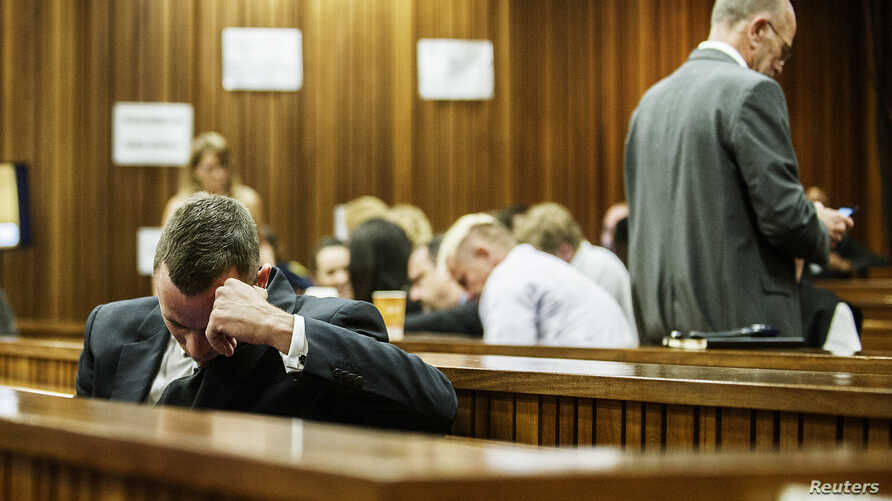 South African Olympic and Paralympic athlete Oscar Pistorius sits in the dock during his murder trial in the North Gauteng High Court in Pretoria, South Africa,  May 8, 2014.
