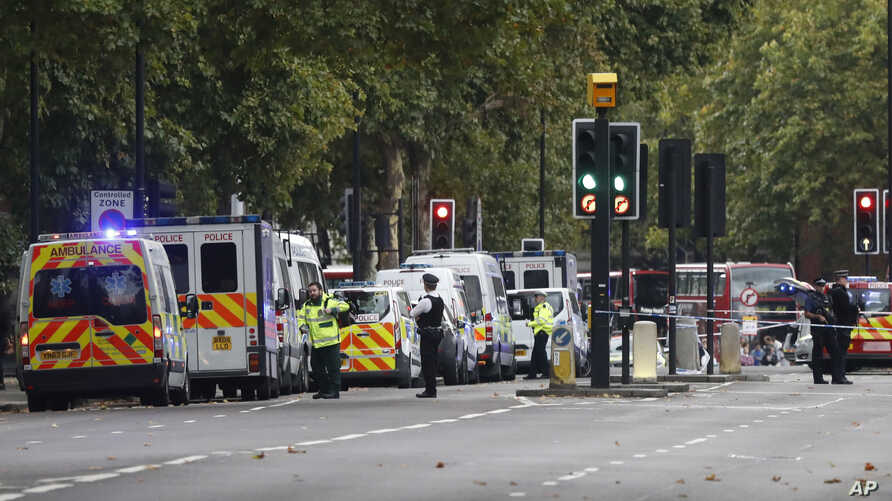 Britain's police and emergency services at the scene of an incident in central London, Saturday, Oct. 7, 2017. London police say emergency services are outside the Natural History Museum in London after a car struck pedestrians.
