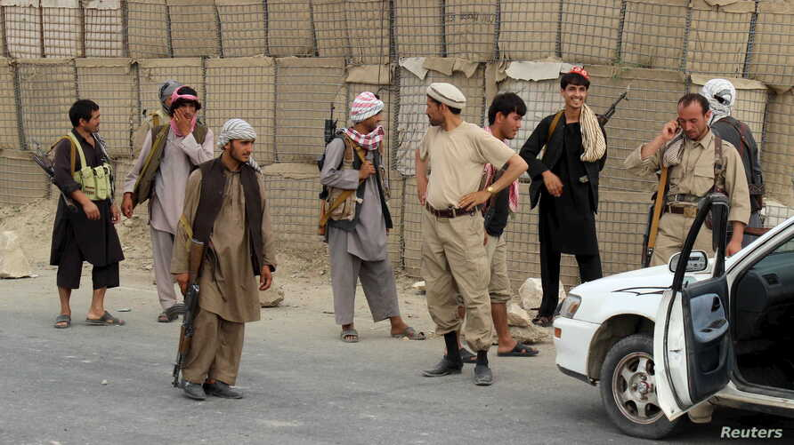 FILE -  Afghan Local Police (ALP) keep watch at a checkpoint at Chardara district, in Kunduz province, Afghanistan, June 23, 2015.