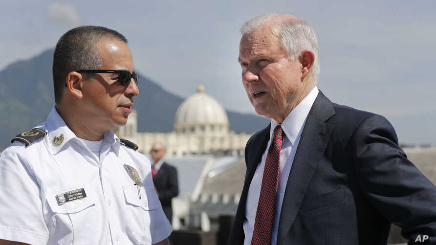 U.S. Attorney General Jeff Sessions speaks with Howard Augusto Cotto Castaneda, Director General of the National Police as they look over the city from the roof during a visit to the National Police Headquarters in San Salvador, El Salvador, July 28,