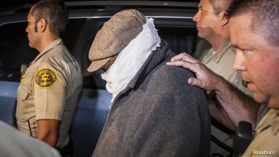 Nakoula Basseley Nakoula (C) is escorted out of his home by Los Angeles County Sheriff's officers in Cerritos, California Sept. 15, 2012.