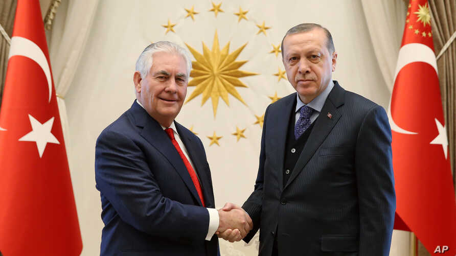 U.S. Secretary of State Rex Tillerson (left) poses with Turkey's President Recep Tayyip Erdogan before their meeting in Ankara, Turkey, March 30, 2017.