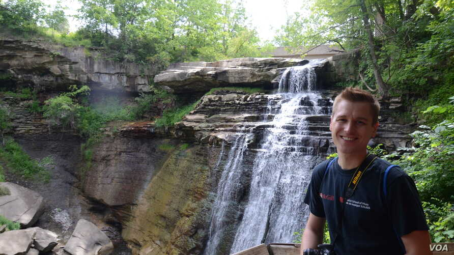 Mikah cools off by a waterfall in Cuyahoga Valley National Park, Ohio.