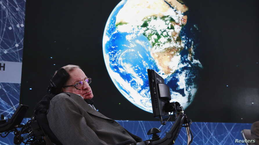 FILE - Physicist Stephen Hawking sits on stage during an announcement of the Starshot initiative with investor Yuri Milner in New York, April 12, 2016. A partnership was announced this week with the European Southern Observatory, which will use one o