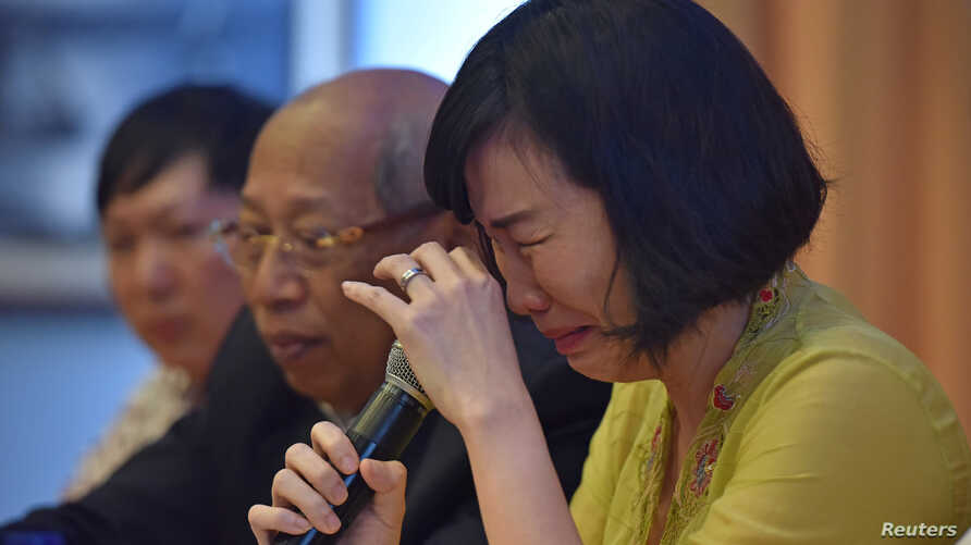 """Veronica Tan, the wife of former Jakarta governor, Basuki Tjahaja Purnama, popularly known as """"Ahok,"""" weeps during a news conference in Jakarta, May 23, 2017  in this photo taken by Antara Foto."""