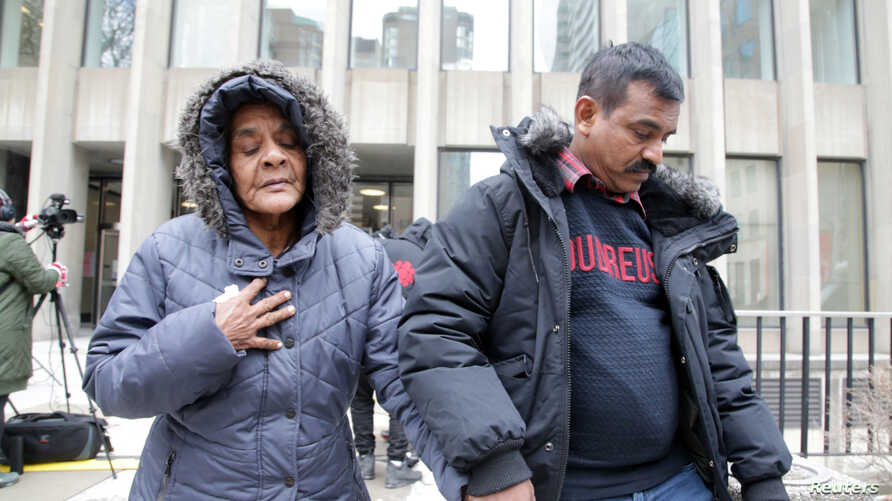 Santhanaladchumy Kanagaratnam, mother of Kirushna Kumar Kanagaratnam who was killed by Bruce McArthur, is led from court after McArthur was sentenced to life in prison following his guilty plea to eight counts of first-degree murder, in Toronto, Feb.